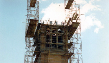 workers ready the top of the tower