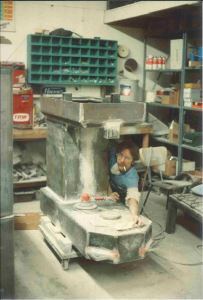 Old picture of young Dave Hinton sanding mixer